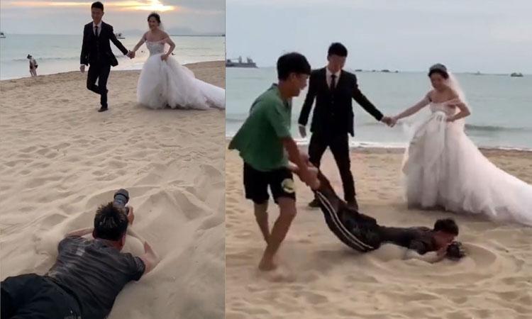 Thợ chụp ảnh bị kéo lê trên cát