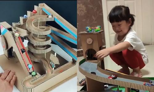 Ông bố Trung Quốc làm đồ chơi bằng bìa giấy cho con gái