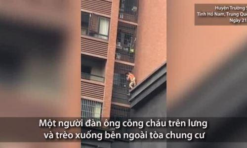 Ông cõng cháu thoát khỏi đám cháy ở chung cư Trung Quốc