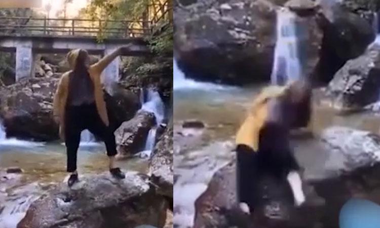 Cô gái ngã xuống suối khi đang nhảy múa