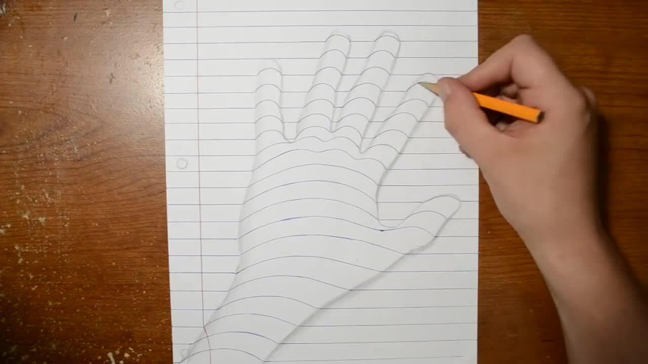Vẽ bàn tay nổi trên giấy