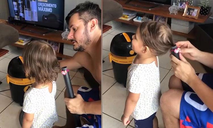 Bố dùng máy hút bụi buộc tóc cho con gái