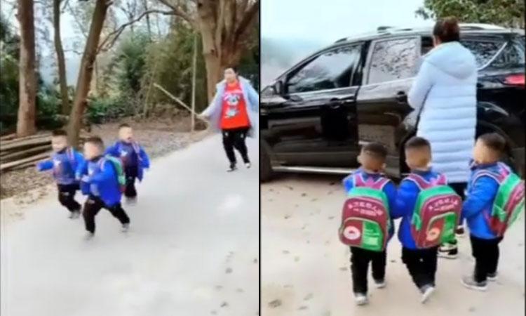 Mẹ 'tăng xông' khi chở ba con trai đi học