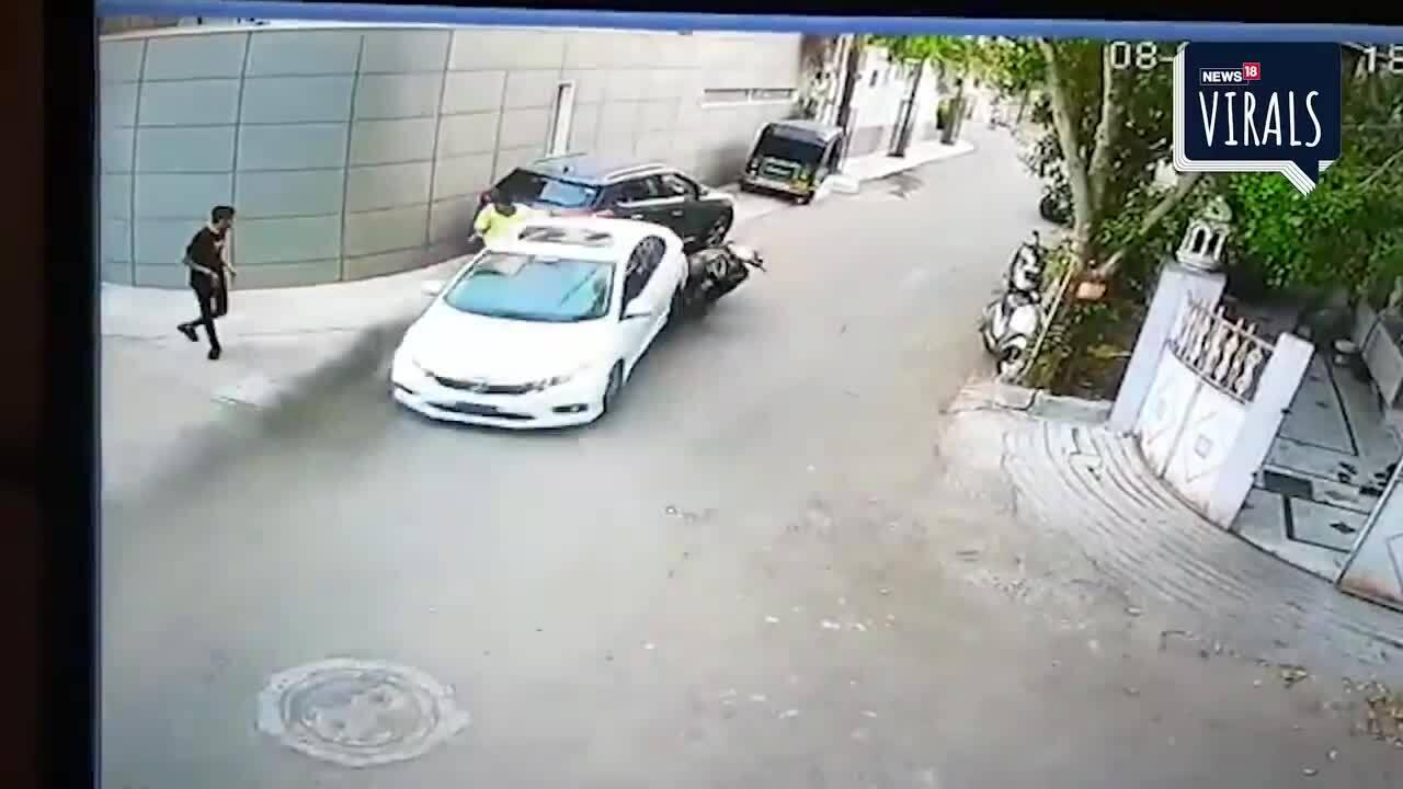 Ôtô cố tình chèn xe máy sau va chạm