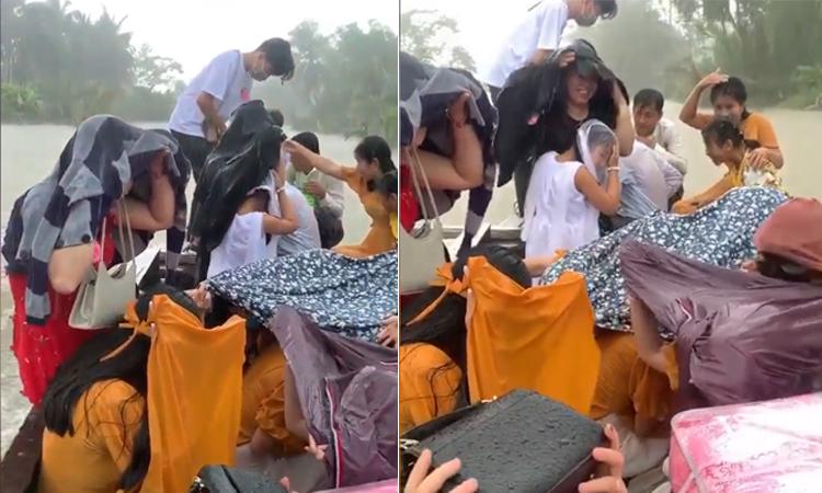Dàn khách mời tắm mưa khi đi đám cưới bằng thuyền